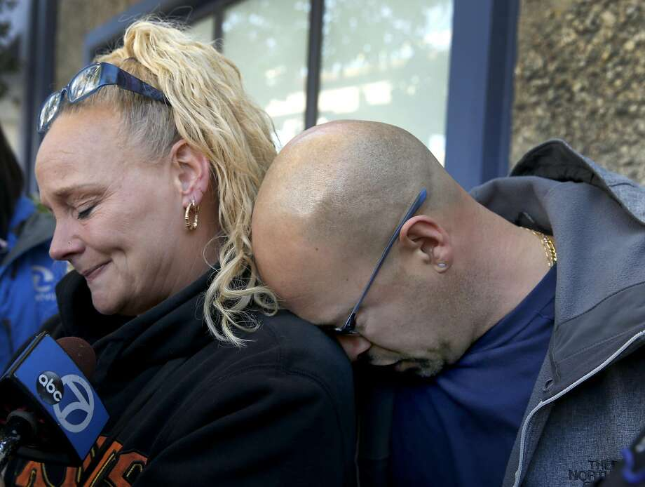 Kim Gregory and her husband David Gregory, Sr. embrace while they wait for updates at an Alameda County Sheriff's office on the fate of their daughter Michela Gregory in Oakland, Calif. on Saturday, Dec. 3, 2016 after at least nine people died and several others are unaccounted for in an overnight fire. Photo: Paul Chinn, The Chronicle