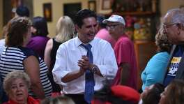 Bexar County Democratic Chariman Manuel Medina talks with supporter's during a Democratic Party to energize party workers to get out the vote Tuesday at Estella's Mexican Restaurant.