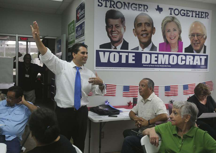 FILE PHOTO - Bexar County Democratic Party Chairman Manuel Medina (arm raised) speaks Monday August 29, 2016 to people gathered at the Democratic Party headquarters that are taking part in a phone bank effort to reach out to potential voters. Photo: John Davenport, Staff / San Antonio Express-News / ©San Antonio Express-News/John Davenport