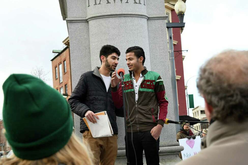 Omar Alrifai of Albany for Syrian Refugees, left, translates for Asad Hussein, right, as they share his story during a rally to denounce hate and embrace diversity on Saturday, Dec. 3, 2016, at Townsend Park in Albany, N.Y. The Capital District Coalition Against Islamophobia held the rally in response to the Ku Klux Klan's victory parade in North Carolina to celebrate President-elect Donald Trump's win. (Cindy Schultz / Times Union)