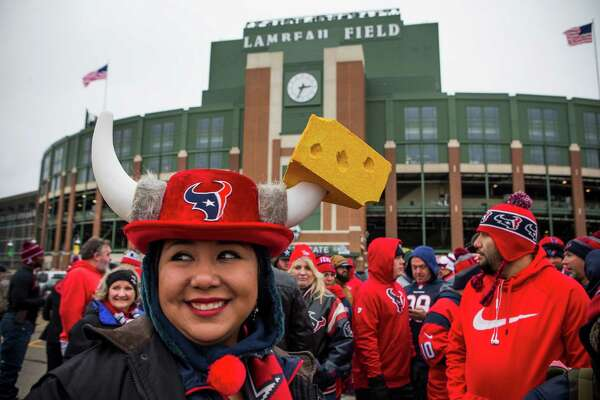 Houston Texans fan Erica DeHoyos gathers with other Texans fans outside Lambeau Field for a group photo on Saturday, Dec. 3, 2016, in Green Bay, Wis. The Texans face the Green Bay Packers on Sunday inside the historic stadium.