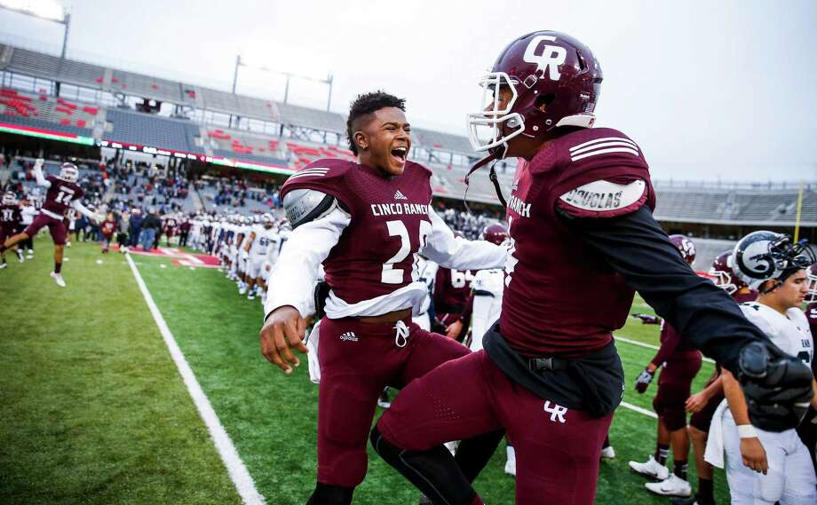 Cinco Ranch defensive back Trey Tollett, left, and receiver Cameron Phelps celebrate after Cinco Ranch beat Cypress Ridge 34-17 in the Class 6A Division II state quarterfinals at TDECU Stadium Saturday, Dec. 3, 2016 in Houston. Photo: Michael Ciaglo, Houston Chronicle / © 2016  Houston Chronicle
