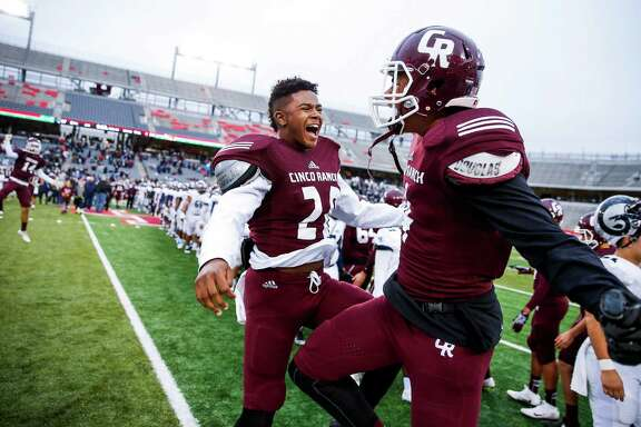Cinco Ranch defensive back Trey Tollett, left, and receiver Cameron Phelps celebrate after Cinco Ranch beat Cypress Ridge 34-17 in the Class 6A Division II state quarterfinals at TDECU Stadium Saturday, Dec. 3, 2016 in Houston.