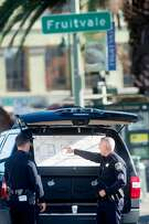 Oakland police officers examine a diagram of the scene of a fatal fire in Oakland, Calif., on Saturday, Dec. 3, 2016.