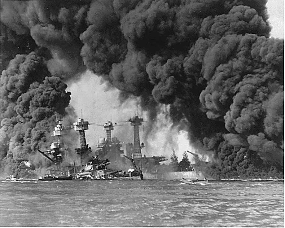 (KRT3) KRT US NEWS STORY SLUGGED: ATTACKS-HISTORY KRT PHOTOGRAPH COURTESY OF THE NATIONAL ARCHIVES/KRT (November 7) Naval photograph documenting the Japanese attack on Pearl Harbor, Hawaii which initiated US participation in World War II. The Battleships USS WEST VIRGINIA and USS TENNESSEE are seen after the Japanese attack on Pearl Harbor on Dec. 7, 1941. (KRT) (B&W ONLY) AP NC KD BL 2001 (Horiz.) (kn) (Additional photo available on KRT Direct, KRT/Newscom or upon request) Photo: NATIONAL ARCHIVES, MBR / NATIONAL ARCHIVES
