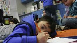 "Third-grader Frank Muniz, 8, works on a math exercise at Harlandale Independent School District's Wright Elementary School, Tuesday, Nov. 15, 2016. Principal Martha Gonzalez and Academic Coordinator Victoria Trevino took over the school two years ago and the school has gone from a Texas Education Agency ""improvement required"" school -- meeting only 2 out of 14 performance rate indicators -- to achieving a ""met standard"" rating with all six TEA distinctions and meeting all indexes of student performance."