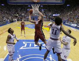 Stanford's Reid Travis (22) puts up a shot during the second half of an NCAA college basketball game against Kansas Saturday, Dec. 3, 2016, in Lawrence, Kan. Kansas won 89-74. (AP Photo/Charlie Riedel)