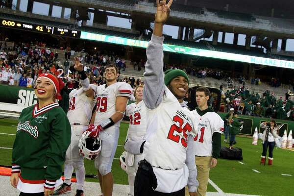 The Woodlands running back Jordan Talford (25) signals to the jersey of The Woodlands linebacker Grant Milton (21) hanging in the pressbox of McLane Stadium following the team's 41-18 win over Round Rock in Division I Region II-6A final game Saturday, Dec. 3, 2016, in Waco. Milton suffered a serious head injury during the team's Nov. 26 win over Austin Bowie in a UIL Class 6A Division I regional semifinal playoff game at Baylor's McLane Stadium. He was taken to a Waco hospital to have emergency surgery where he remains in a medically induced coma.