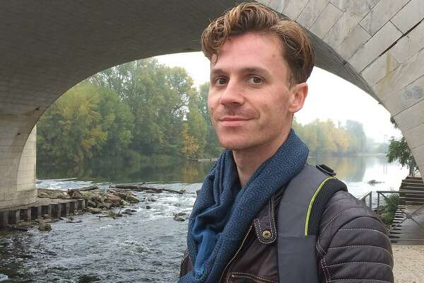 Jason McCarty, a 36-year-old sound artist from Iowa, was among the attendees who were unaccounted for / missing   following the warehouse fire in the Fruitvale neighborhood of Oakland during the early hours of Saturday December 3, 2016. He is pictured standing by the Loire River in Tours, France in October, while visiting his girlfriend, Grace Lovio. Photo courtesy Grace Lovio
