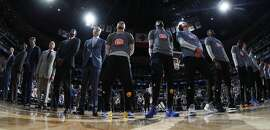 Golden State Warriors guard Stephen Curry (30), center left, and Golden State Warriors forward Kevin Durant (35) center right, stand with teammates during the playing of the National Anthem before facing the Denver Nuggets in the first half of an NBA basketball game Thursday, Nov. 10, 2016, in Denver. (AP Photo/David Zalubowski)