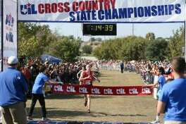 New Braunfels Canyon's Sam Worley approaches the finish line of the 6A boys 5K during the UIL cross country state meet at Settlers Park in Round Rock on Saturday, Nov. 12, 2016. (staff photo)