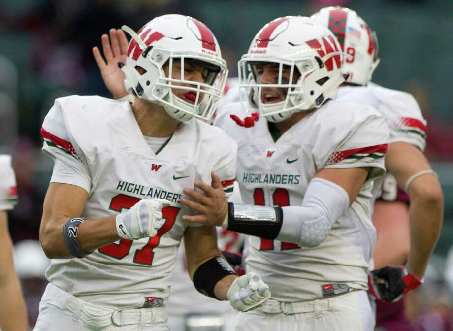 The Woodlands linebacker Cole Sichel (37) celebrates with linebacker Zach La Canfora (11) after hitting Round Rock running back Marquis Brown (36) in the backfield for a four-yard loss on third down during the first quarter of a Division I Region II-6A final game at McLane Stadium Saturday, Dec. 3, 2016, in Waco. Photo: Jason Fochtman, Staff Photographer / Houston Chronicle