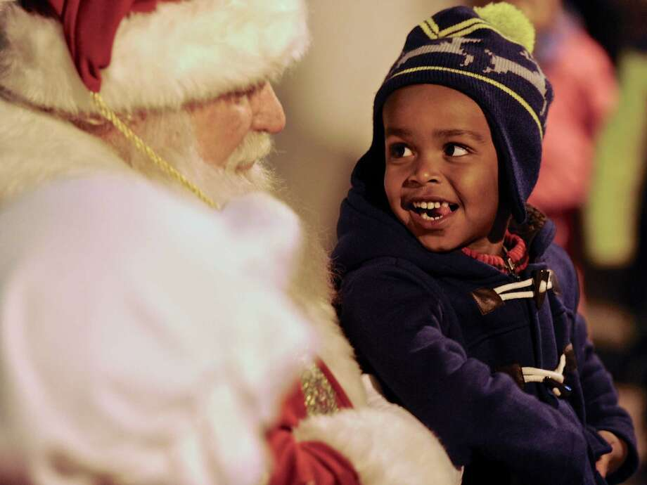 "Zachary Ellis, 3, talks with Santa at City Center Danbury's annual ""Light the Lights"" holiday season celebration on the Library Plaza, Saturday night, December 3, 2016, in Danbury, Conn. Photo: H John Voorhees III, Hearst Connecticut Media / The News-Times"