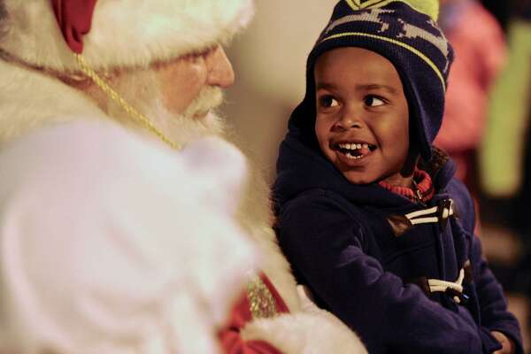 "Zachary Ellis, 3, talks with Santa at City Center Danbury's annual ""Light the Lights"" holiday season celebration on the Library Plaza, Saturday night, December 3, 2016, in Danbury, Conn."