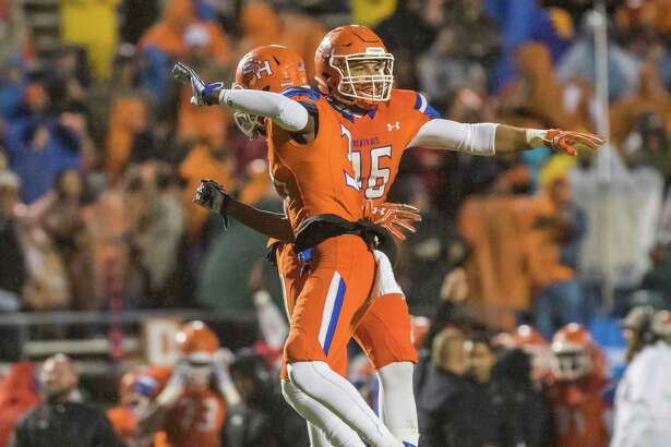 Sam Houston State's Carlos Teal (Left) and A.J. Davis (Right) celebrate after Chattanooga turned the ball over on downs in a NCAA Division I Football Championship Subdivision playoff football game at Bowers Stadium on Saturday, December 3, 2016, in Huntsville, Tx.