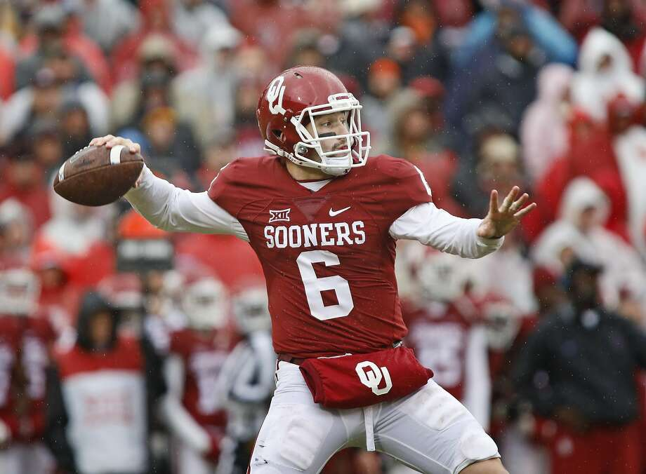 Oklahoma quarterback Baker Mayfield had 288 yards and three touchdowns as the Sooneres wrapped up the Big 12 title. Photo: Brett Deering, Getty Images