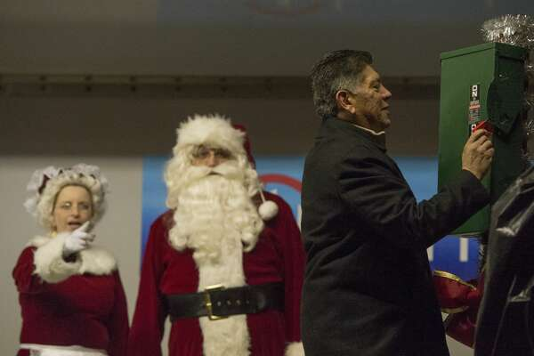 Midland Mayor Jerry Morales, with the help of Mr. and Mrs. Claus, light the City of Midland Christmas Tree Saturday 12-03-16 at Wadley Barron Park. Tim Fischer/Reporter-Telegram