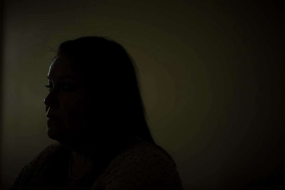 A survivor of domestic abuse who remains anonymous for her safety sits for a portrait at Family Violence Prevention Services in San Antonio, Texas on October 25, 2016.
