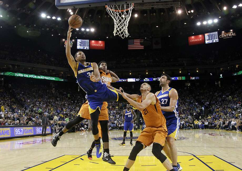 Golden State Warriors' Stephen Curry, left, drives to the basket next to Phoenix Suns' Eric Bledsoe, second from left, Suns' Alex Len (21) and Warriors' Zaza Pachulia during the second half of an NBA basketball game Sunday, Nov. 13, 2016, in Oakland, Calif. (AP Photo/Marcio Jose Sanchez) Photo: Marcio Jose Sanchez, Associated Press