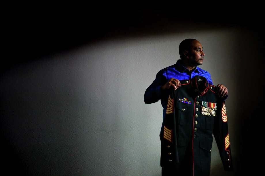 First Sgt. Arthur Davis displays his uniform on Friday. Davis was out of the Marines for one year when he was charged with aggravated assault with a deadly weapon. He pleaded guilty and went to veterans court. Photo: Michael Ciaglo, Staff / © 2016  Houston Chronicle