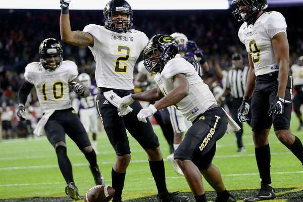 Grambling State University players celebrate the game-winning touchdown made by Martez Carter, second right, during the fourth quarter of the Southwestern Athletic Conference Championship Game against Alcorn State University at NRG Stadium Saturday, Dec. 3, 2016, in Houston. The Tigers defeated the Braves 27-20.