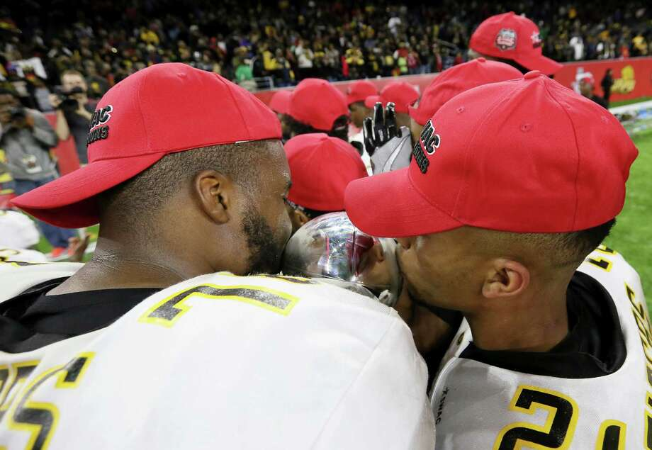 Grambling State University's Trent Scott, left, and Tyler Oliver kiss the Southwestern Athletic Conference Championship trophy after defeating Alcorn State University at NRG Stadium Saturday, Dec. 3, 2016, in Houston. The Tigers defeated the Braves 27-20. Photo: Yi-Chin Lee, Houston Chronicle / © 2016  Houston Chronicle