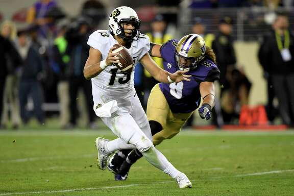 SANTA CLARA, CA - DECEMBER 02:  Sefo Liufau #13 of the Colorado Buffaloes is pressured by Benning Potoa'e #8 of the Washington Huskies during the Pac-12 Championship game at Levi's Stadium on December 2, 2016 in Santa Clara, California.  (Photo by Thearon W. Henderson/Getty Images)