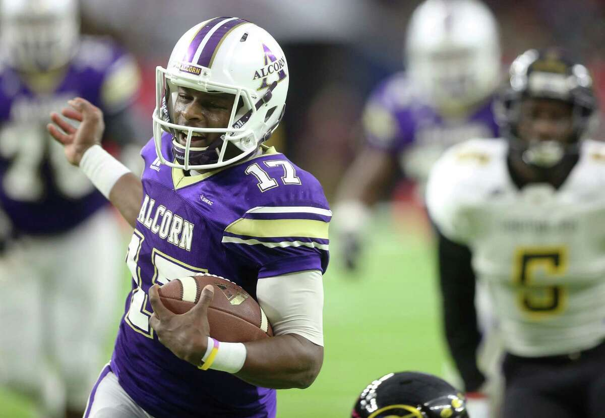 Alcorn State University quarterback Lenorris Footman (17) carries the ball toward the end zone and scores a touchdown during the first quarter of the Southwestern Athletic Conference Championship Game against Grambling State University at NRG Stadium Saturday, Dec. 3, 2016, in Houston.