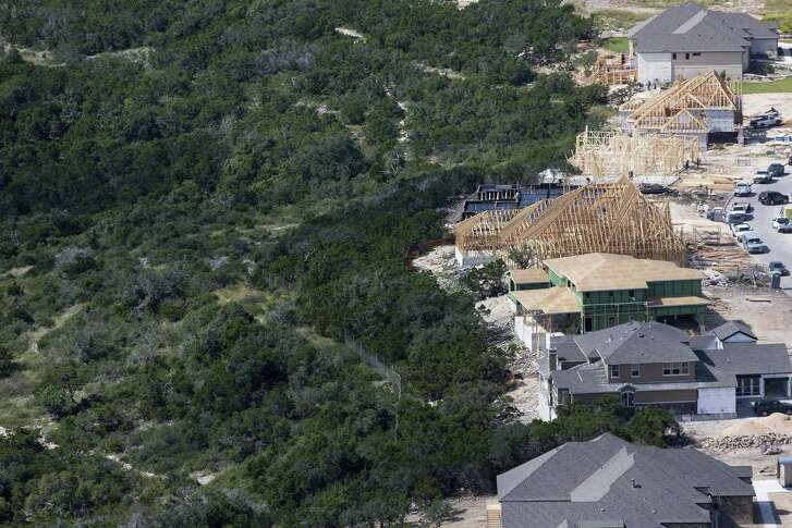 Development along I-10 north of Loop 1604 has begun to surround Friedrich Wilderness Park as seen in this Oct. 6, 2016 aerial image. These homes are being built along the north fence line of the park.