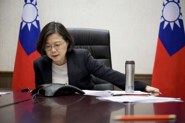 In this Friday, Dec. 2, 2016 photo released by Taiwan Presidential Office Saturday, Dec. 3, 2016, Taiwan's President Tsai Ing-wen speaks with U.S. President-elect Donald Trump through a speaker phone in Taipei, Taiwan. (Taiwan Presidential Office via AP) ORG XMIT: TPE101