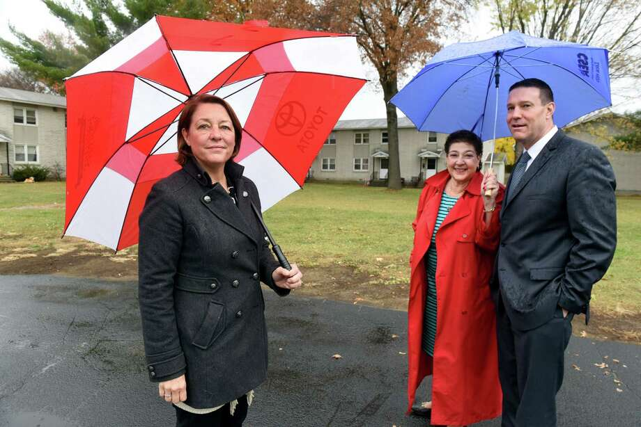 Mayor Joanne Yepsen, left, joins Cheryl Hage-Perez, executive director of Saratoga County Rural Preservation Co., center, and Paul Feldman, executive director of Saratoga Springs Housing Authority, at site of proposed affordable housing on Tuesday, Nov 15, 2016, at Vanderbilt Terrace in Saratoga Springs, N.Y. (Cindy Schultz / Times Union) Photo: Cindy Schultz / Albany Times Union