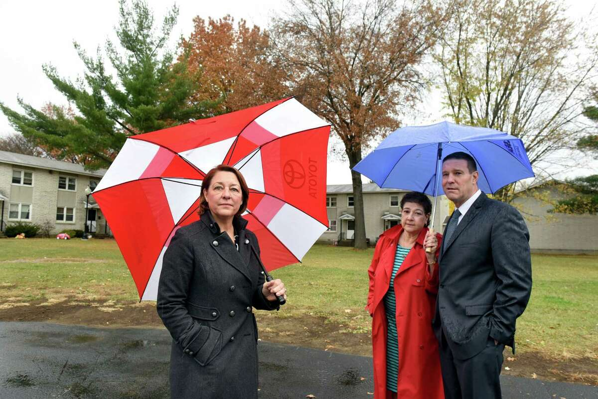 Mayor Joanne Yepsen, left, joins Cheryl Hage-Perez, executive director of Saratoga County Rural Preservation Co., center, and Paul Feldman, executive director of Saratoga Springs Housing Authority, at site of proposed affordable housing on Tuesday, Nov 15, 2016, at Vanderbilt Terrace in Saratoga Springs, N.Y. (Cindy Schultz / Times Union)
