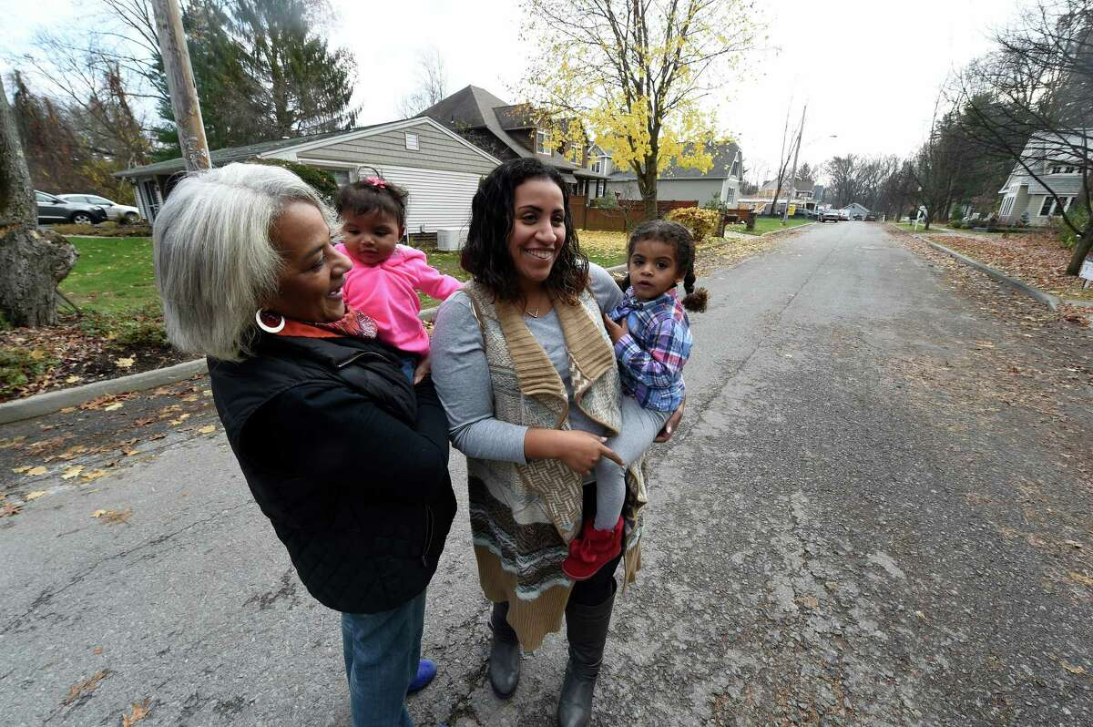 Johnnie Roberts holds her grand daughter Ellie McKinnon age 8 months and stands in her old neighborhood with her daughter Hallie McKinnon and her daughter Addison McKinnon who is 2 1/2, Thursday Nov. 17, 2016 in Saratoga Springs, N.Y. (Skip Dickstein/Times Union)