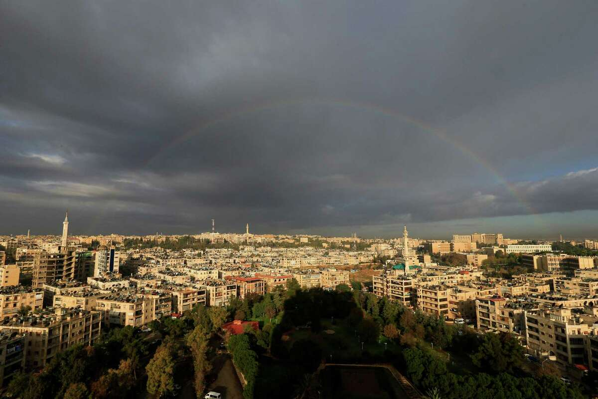 A rainbow appears after a heavy rain over the Aleppo, Syria, Saturday, Dec. 3, 2016. (AP Photo/Hassan Ammar) ORG XMIT: HAS136