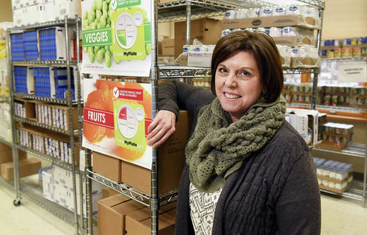 Food pantry director Angela Warner at St Vincent?'s Parish Center's pantry Friday Dec. 2, 2016 in Albany, NY. (John Carl D'Annibale / Times Union)