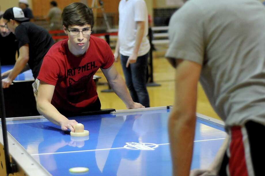Ben Ebers, a University of Houston student, was one of more than 60 competing in the U.S. Air Hockey Association's global tournament this weekend at UH. Photo: Dave Rossman, Freelance / Dave Rossman