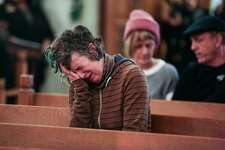 Genevieve Griesau, who has loved ones still unaccounted for, can't hold back her emotions at the vigil at the Chapel of the Chimes in Oakland on Saturday night following the deadly warehouse fire in the city on Saturday morning, December 3, 2016 in Oakland, Calif.