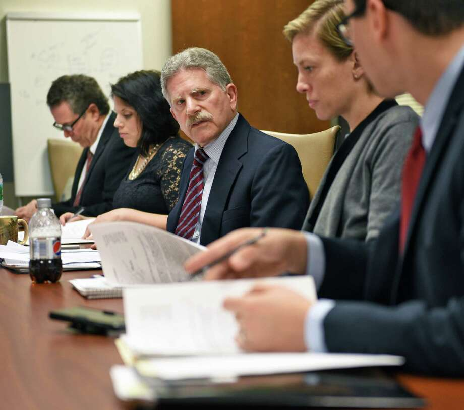 Executive director Robert Freeman, center, during the annual meeting of the NYS Committee on Open Government as it discusses it's annual report that will call for the repeal of a state law that prohibits the public disclosure of police officers' personnel records without a court order Wednesday Nov. 30, 2016 in Albany, NY.  (John Carl D'Annibale / Times Union) Photo: John Carl D'Annibale / 20038972A