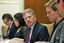 Executive director Robert Freeman, center, during the annual meeting of the NYS Committee on Open Government as it discusses it's annual report that will call for the repeal of a state law that prohibits the public disclosure of police officers' personnel records without a court order Wednesday Nov. 30, 2016 in Albany, NY. (John Carl D'Annibale / Times Union)