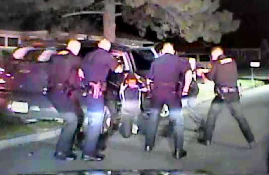 Frame grab from video showing Albany County sheriff's Sgt. Vincent Igoe Jr., using his Taser on a suspect who was on his knees with his hands on his head while surrounded by police. Igoe was suspended last month after sheriff's officials reviewed the video. (Albany County Sheriff's Department)