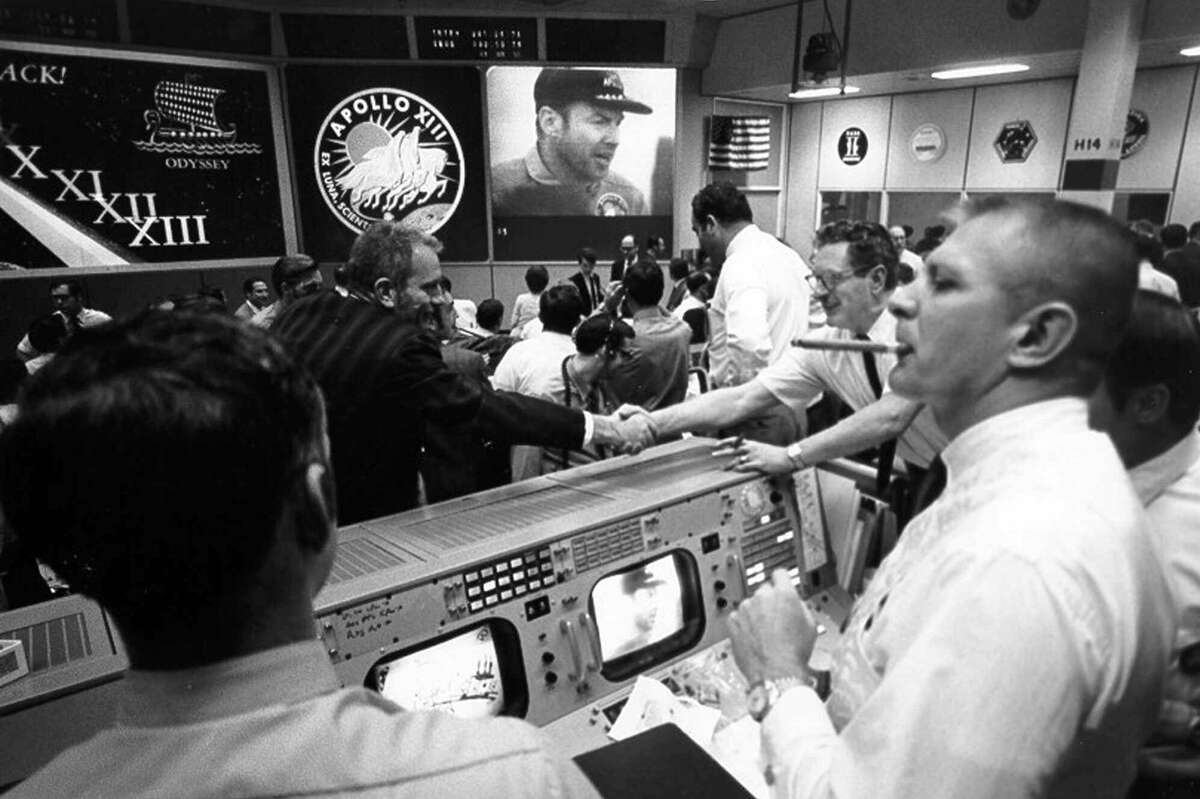 Gene Kranz, right, celebrates the Apollo 13 splashdown with a cigar at Johnson Space Center's Mission Control, April 17, 1970. (For more photos of Mission Control's glory days, scroll through the slideshow.)