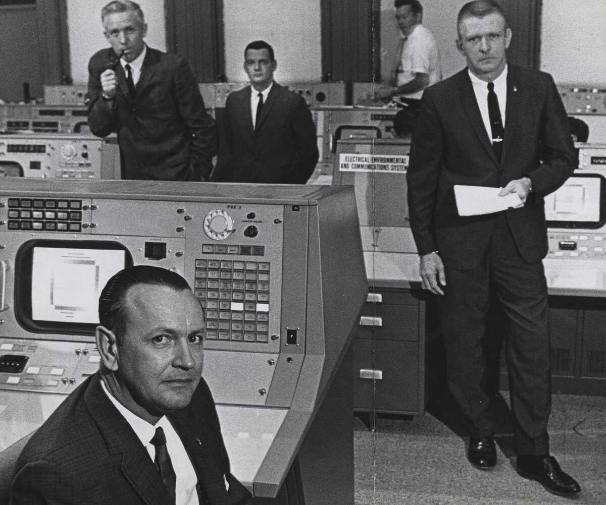 June 1965: flight director Christopher Kraft, foreground, and (L-R, in suits) John D. Hodge, chief of the flight control division; Glynn Lunney, flight director at Cape Kennedy during launch phase only; and Gene Kranz, who spelled Kraft as flight director.