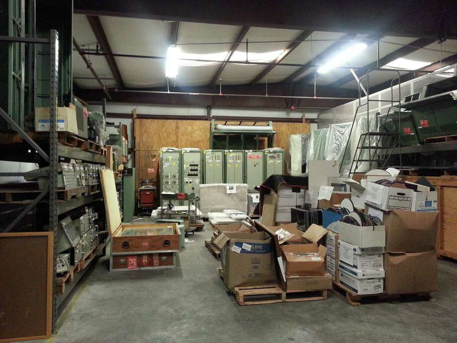 A storage area in Johnson Space Center's Building 425 is stacked with artifacts and equipment for MOCR2's restoration. Photo: Sandra Tetley