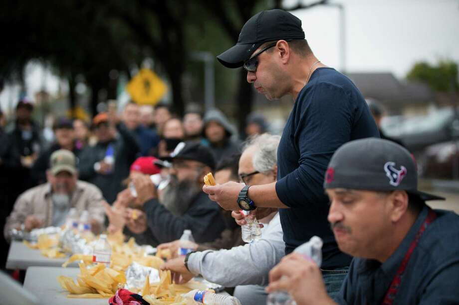 John Anthony Gaitan, 46, stays focused on his way to winning Saturday's tamale-eating contest. He devoured 24 tamales in just over 21/2 minutes. Photo: Marie D. De Jesus, Staff / © 2016 Houston Chronicle