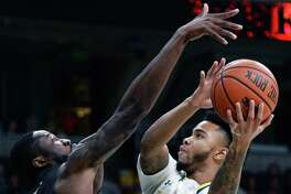 Siena's #1 Marquis Wright drives through Fairfield defenders Amadou Sidibe, left, and Jerome Segura on his way to the basket during Saturday's game at the Times Union Center Dec. 3, 2016 in Albany, NY. (John Carl D'Annibale / Times Union)