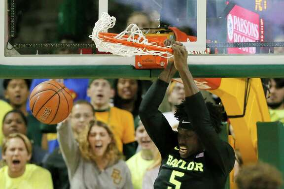 Baylor's Johnathan Motley rattles the rim on a dunk in the first half. Motley had 17 points and eight rebounds in the Bears' 76-61 victory over Xavier.