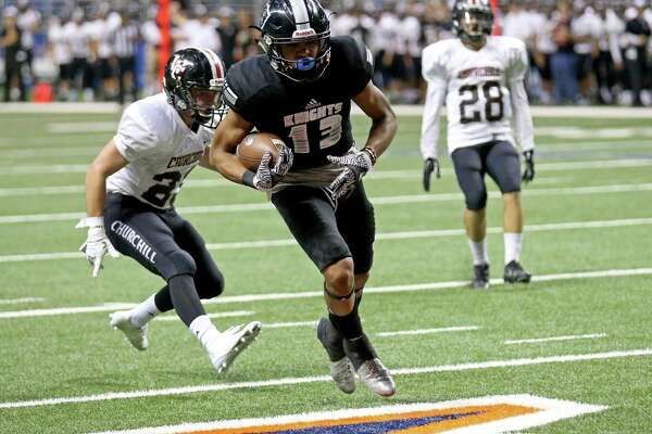 Steele's Onyx Smith scores a touchdown on a pass play ahead of Churchill's Thomas Sharrick during first half action of their Class 6A Division II state quarterfinal playoff game held Saturday Dec. 3, 2016 at the Alamodome.