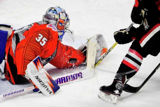 Sound Tigers goalie Stephon Williams blocks a shot attempt by Binghamton's Chad Nehring during hockey action at the Webster Bank Arena in Bridgeport, Conn. on Saturday Dec. 3, 2016.