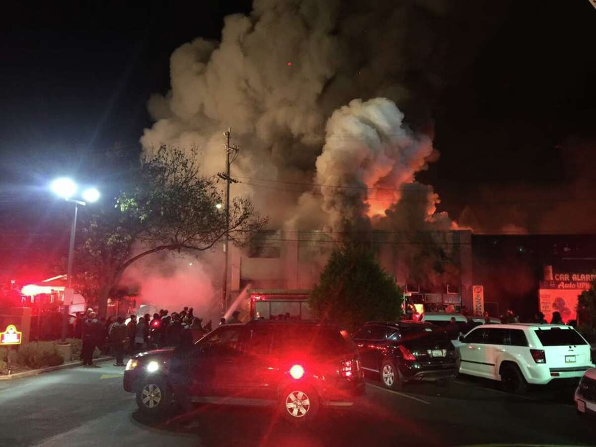 Fire crews battle a blaze in a warehouse known as the Oakland Ghost Ship on Friday, Dec. 2 at 1305 31st Ave. near International Boulevard in the Fruitvale neighborhood.