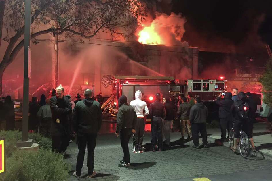 Fire crews battle a blaze in a warehouse known as the Oakland Ghost Ship on Friday, Dec. 2 at 1305 31st Ave. near International Boulevard in the Fruitvale neighborhood. The day after the blaze, 9 people were dead and dozens were missing.